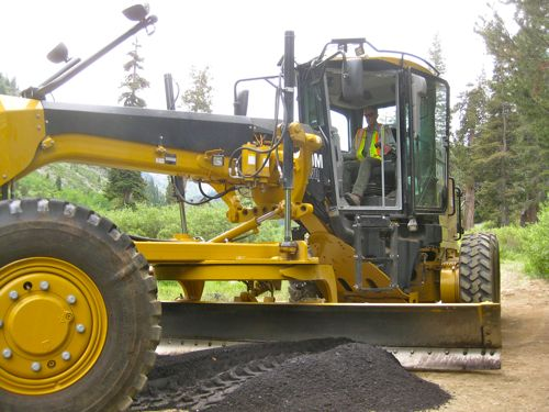 Kirk operating a big yellow machine in Mineral King photo by Michael Botkin