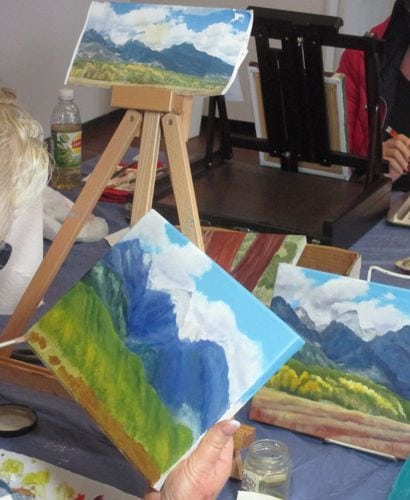 A rebel set aside her Sequoia tree to finish a painting of the Tetons that she began last year.
